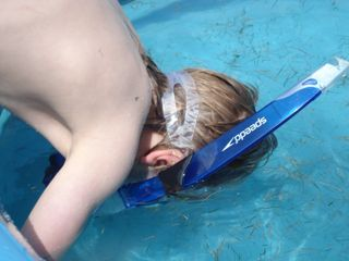 Logan in snorkel in pool